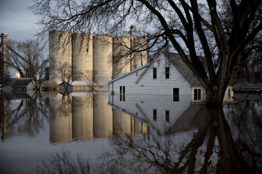 Floodwaters surround homes and a grain elevator in Hamburg