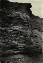 Picture of a rocky formation near a beach