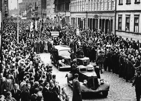 Picture of cars and people in a crowd